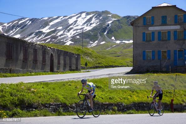 Cyclists riding British Scott bike Pinarello on The Stelvio Pass Passo dello Stelvio Stilfser Joch in Italy
