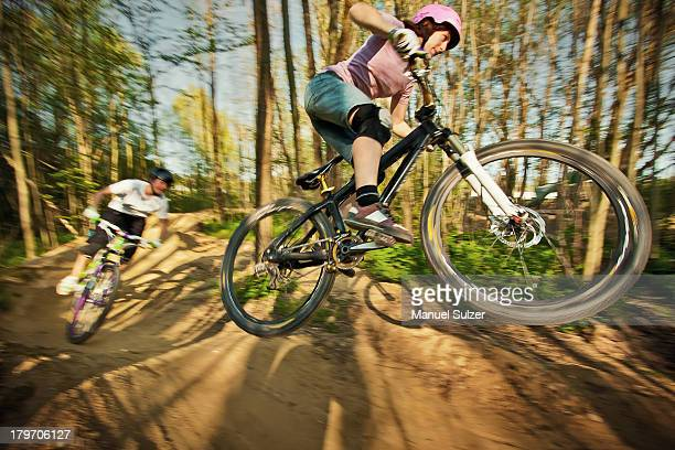 Cyclists riding on dirt bike course