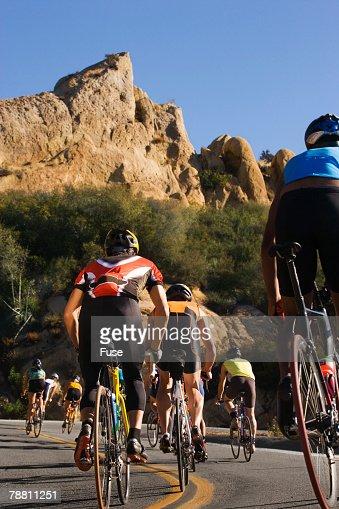Cyclists Rounding a Curb During a Triathlon