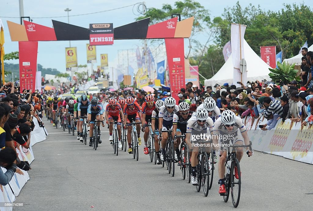 Cyclists sprint to finish during stage eight of the 2016 Tour de Singkarak Bukittinggi Padang 146 km on August 14 2016 in Padang Indonesia