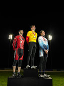 Cyclists standing on podium, low angle view
