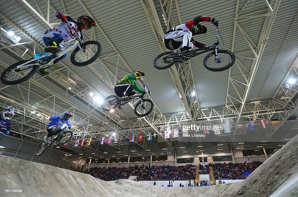Cyclists take a jump during the Men's Elite 1/8 Finals in the UCI BMX Supercross World Cup at the National Cycling Centre on April 20, 2013 in Manchester, England.
