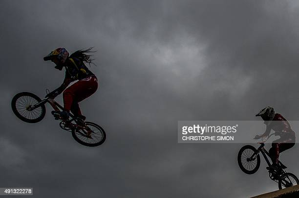 Cyclists take part in a BMX test event for the 2016 Rio Olympics Games at the Cidade Olimpica of Deodoro in Rio de Janeiro Brazil on October 4 2015...