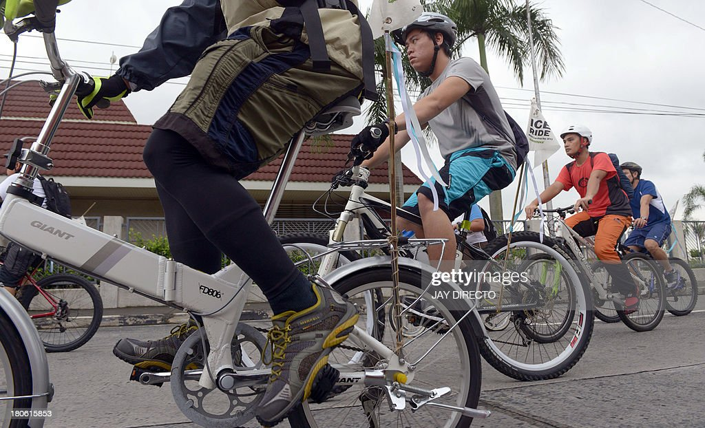 Cyclists take part in an 'Ice Ride' to mark 'World Car Free Day' in Manila on September 15, 2013. Environmental activists from Greenpeace and the local group 'Firefly Brigade' took to their bikes to pedal 14 kilometers (9 miles) to join an 'Ice Ride', a global mass bike ride taking place in 110 cities in 36 countries aimed at saving the Arctic. World Car Free Day usually takes place in mid-September and is an annual celebration of cities and public life, free from the noise, stress and pollution of cars aimed at getting people to think about their car use and its impact on the environment, as well as promoting alternatives. AFP PHOTO / Jay DIRECTO