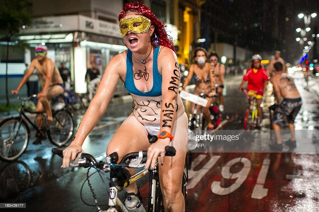 Cyclists take part in the 6th 'Naked Pedalling', an annual cycling event, at Paulista Avenue in Sao Paulo, Brazil, on March 9, 2013. The event welcomes naked cyclists to celebrate cycling and the human body and protest against cars, gas emission and agressive drivers. AFP PHOTO/Yasuyoshi CHIBA