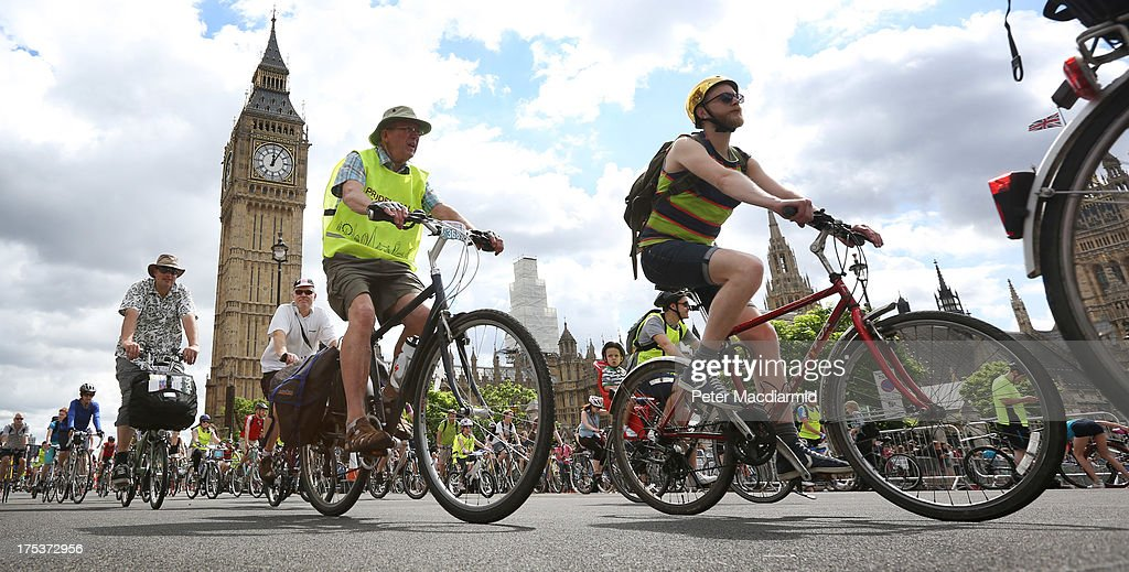 Cyclists take part in the Ride London Freecycle event pass near Parliament and the Queen Elizabeth Tower, known as Big Ben, on August 3, 2013 in London, England. Up to 50, 000 cyclists are expected to ride the eight mile traffic free route through central London.