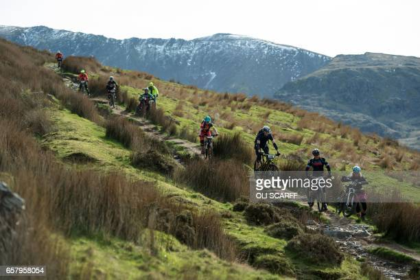 TOPSHOT Cyclists take part in the 'Snowdonia Mountain Bike Challenge' near Llanberis north Wales on March 26 2017 The Challenge is the only mountain...
