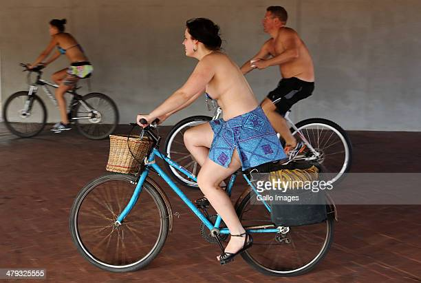 Cyclists take part in the World Naked Bike Ride on March 8 2014 in Cape Town South Africa This annual event promoted raising awareness about Clean...