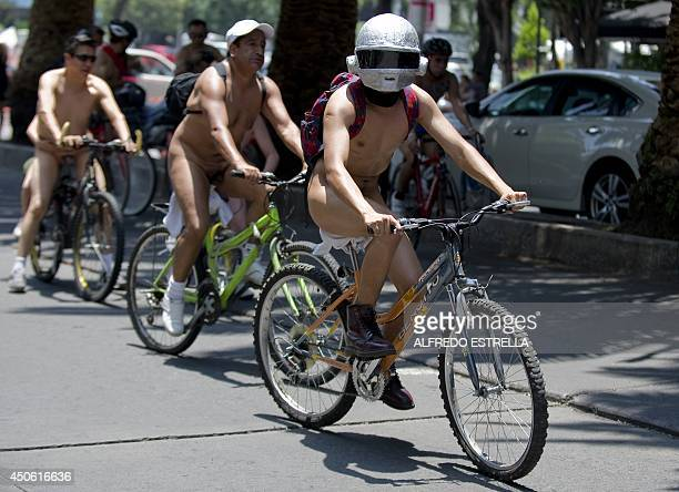 Cyclists take part in the World Naked Bike Ride to protest against cars gas emissions from cars and agressive drivers in Mexico City on June 14 2014...