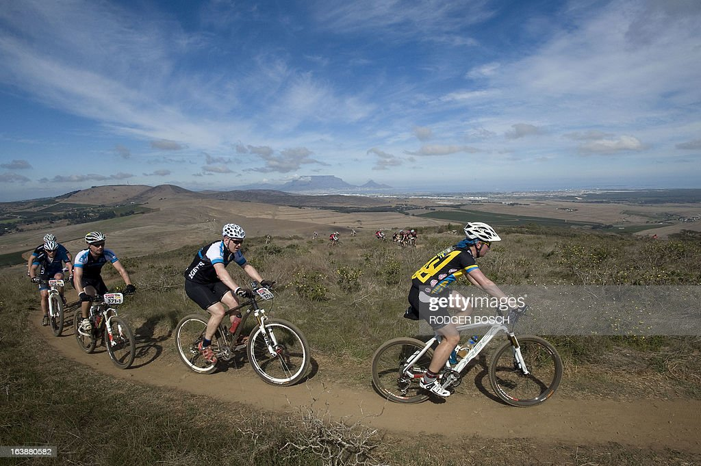 Cyclists take part on March 17, 2013 during the prolog stage of the 2013 Cape Epic Mountain Bike Race at the Meerendal Wine estate, about 30 kms from Cape Town. The eight-day race covers a distance of more than 800 kms, climbing more than 15,000 meters. AFP PHOTO / RODGER