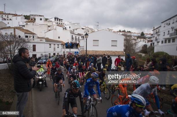 Cyclists take the start of the last stage of the 'Ruta del Sol' tour a 1515 km ride from Setenil de las Bodegas to Coin on February 19 2017 / AFP /...