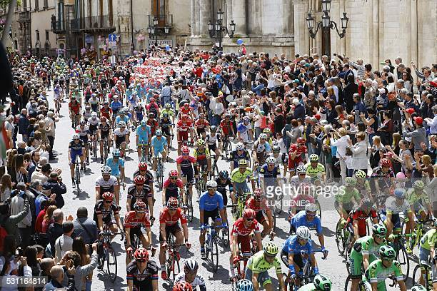 Cyclists take the start of the seventh stage a 211km ride from Sulmona to Foligno during the 99th Giro d'Italia cycling race on May 13 2016 in...