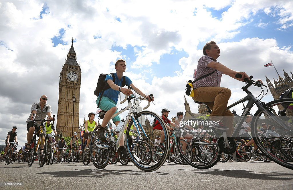 Cyclists taking part in the Ride London Freecycle event pass near Parliament and the Queen Elizabeth Tower, known as Big Ben, on August 3, 2013 in London, England. Up to 50, 000 cyclists are expected to ride the eight mile traffic free route through central London.