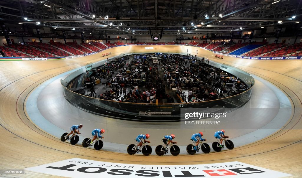 Cyclists train ahead of the Women's Team Pursuit qualifier at the UCI Track Cycling World Championships in SaintQuentinenYvelines near Paris on...