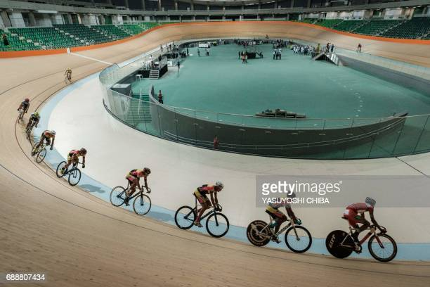 TOPSHOT Cyclists train at the Olympic Velodrome that reopened for the weekend's 'Rio Bike Fest' event at the Olympic Park in Rio de Janeiro Brazil on...