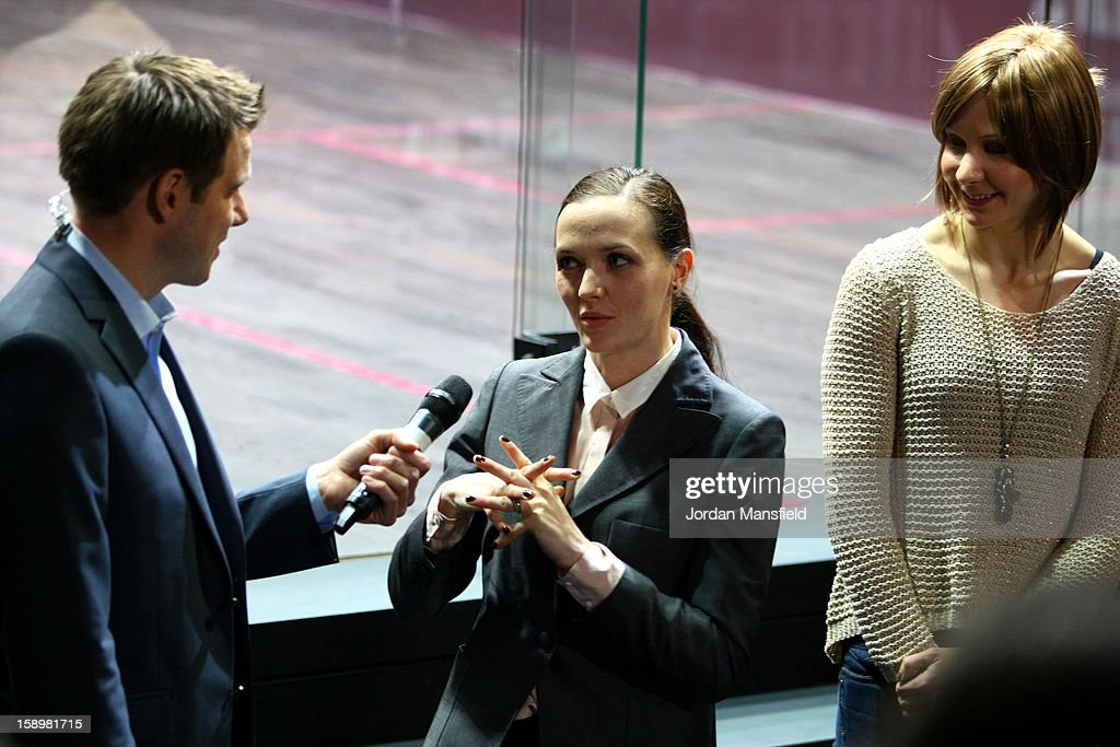Cyclists Victoria Pendleton (center) and Joanna Rowsell (right) talk to Tony Wrighton during Day 3 of the ATCO World Series Squash Finals played at Queens Club on January 4, 2013 in London, England.