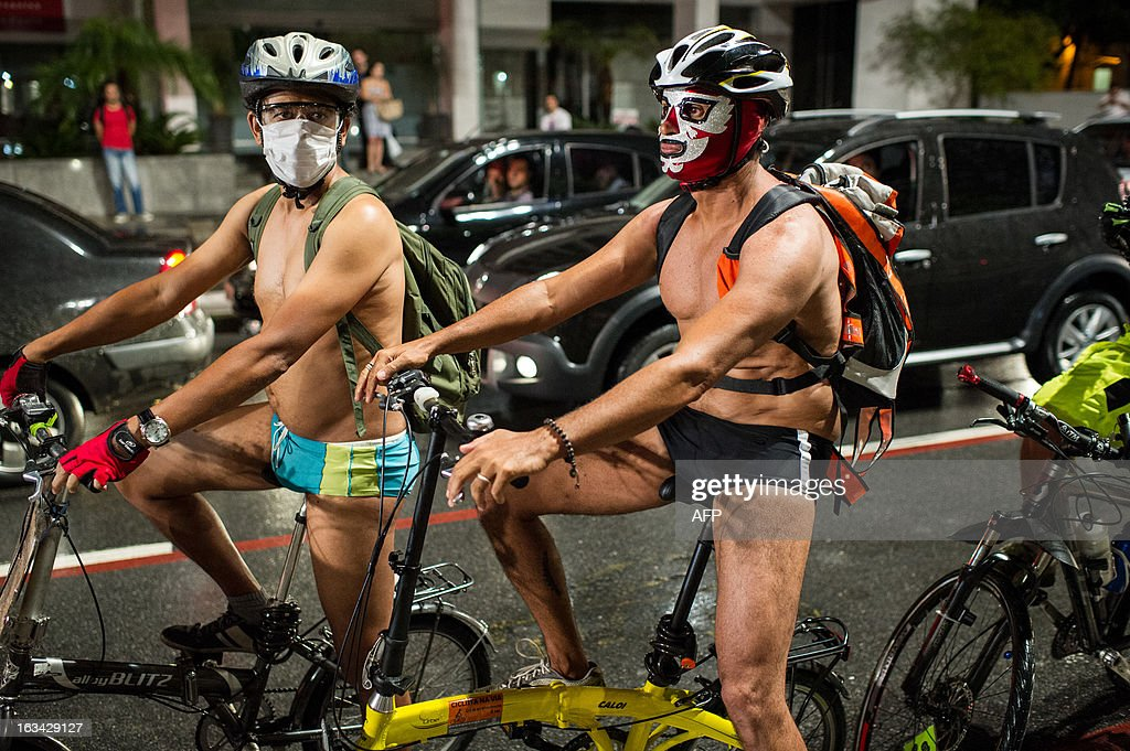 Cyclists wait for the start of the 6th 'Naked Pedalling', an annual cycling event, at Paulista Avenue in Sao Paulo, Brazil, on March 9, 2013. The event welcomes naked cyclists to celebrate cycling and the human body and protest against cars, gas emission and agressive drivers. AFP PHOTO/Yasuyoshi CHIBA