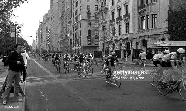 Cyclists whiz up Fifth Ave under fair skies yesterday as they take part in the Peugeot Apple Lap a 75mile race through Manhattan One of the riders...
