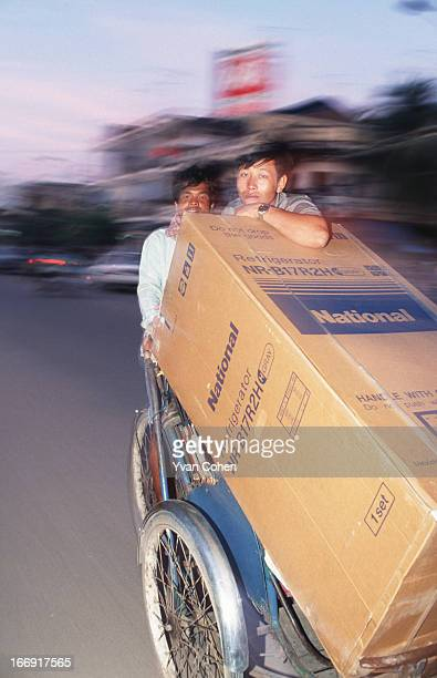 A cyclo is used to transport a newly purchased fridge through the streets of Phnom Penh The advent of peace in Cambodia has allowed the economy to...