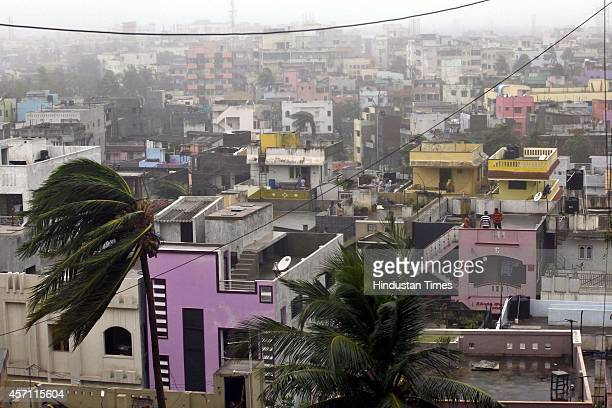 Cyclone Hudhud hit India's east coast with monstrous ferocity on Sunday killing at least six people and leaving behind a trail of destruction in...