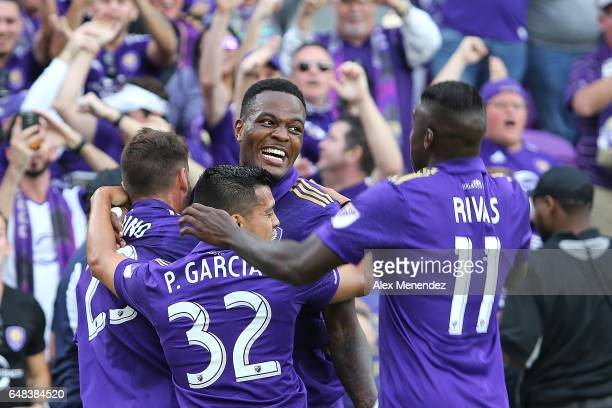Cyle Larin of Orlando City SC celebrates his goal with Matias Perez Garcia and Carlos Rivas and Antonio Nocerino of Orlando City SC during a MLS...