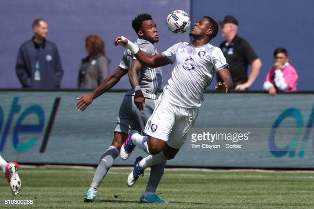Cyle Larin of Orlando City SC is challenged by Rodney Wallace of New York City FC in action during the New York City FC Vs Orlando City SC regular...