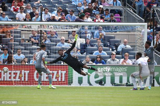 Cyle Larin of Orlando City SC scores the second of his two goals as his header beat goalkeeper Sean Johnson of New York City FC in action during the...