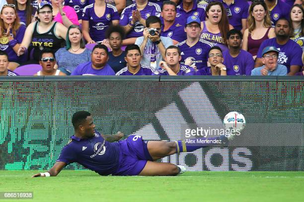 Cyle Larin of Orlando City SC tries to keep the ball in play during a MLS soccer match between New York City FC and the Orlando City SC at Orlando...
