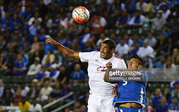 Cyle Larn of Canada vies for the header with Alexander Mendoza of El Salvador during their 2015 Concacaf Gold Cup match in Carson California on July...