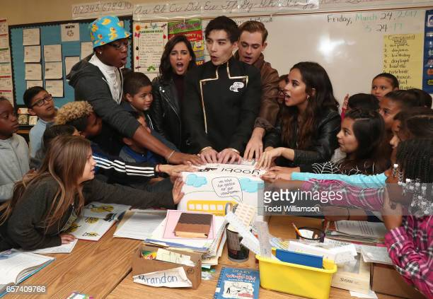 Cyler Naomi Scott Ludi Lin Dacre Montgomery and Becky G open a Yoobi Box with students at a Saban's Power Rangers 'Give Day' Event with Yoobi School...