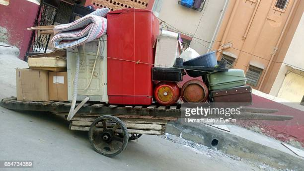 Cylinders And Suitcases On Push Cart At Street