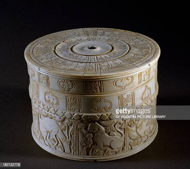 Cylindrical box with lid decorated with reliefs depicting animals and floral motifs ivory Fatimid period 12th century Cairo Islamic Art Museum
