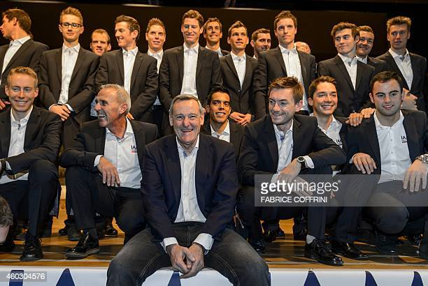 IAM Cyling General Manager Michel Thetaz and racers pose for a family picture during the presentation of the 2015 squad of IAM Cycling team on...
