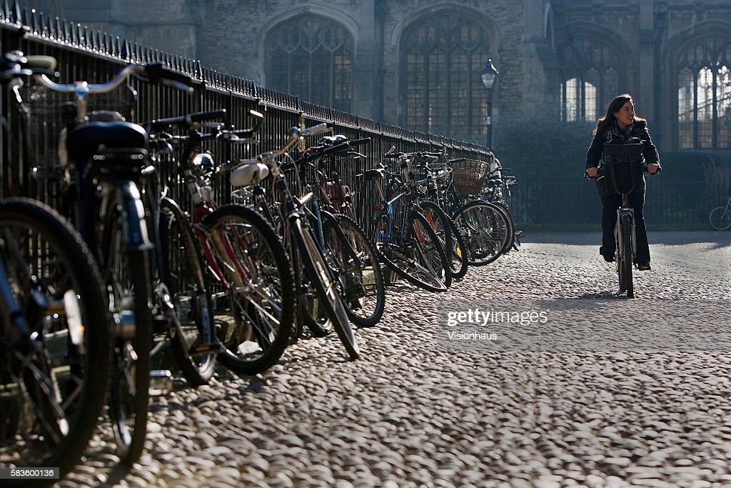 Cylist in Radcliffe Square Oxford Affectionately named 'the city of dreaming spires' by nineteenth century English poet Matthew Arnold a reference to...