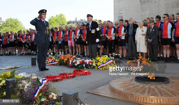 Cylists from the Help for Heroes Band of Brothers bike riders attend a wreath laying ceremony at the Arc de Triomphe Paris with Defence Attache Air...