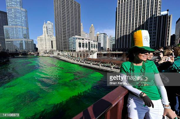 Cynara Martin stands on the Columbus Drive bridge as members of the plumbers' union dye the Chicago River green for St Patrick's Day on March 17 2012...