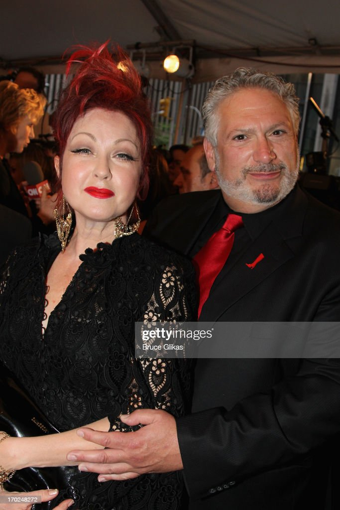 <a gi-track='captionPersonalityLinkClicked' href=/galleries/search?phrase=Cyndi+Lauper&family=editorial&specificpeople=171290 ng-click='$event.stopPropagation()'>Cyndi Lauper</a> and actor Actor <a gi-track='captionPersonalityLinkClicked' href=/galleries/search?phrase=Harvey+Fierstein&family=editorial&specificpeople=206751 ng-click='$event.stopPropagation()'>Harvey Fierstein</a> attends the 67th Annual Tony Awards at Radio City Music Hall on June 9, 2013 in New York City.