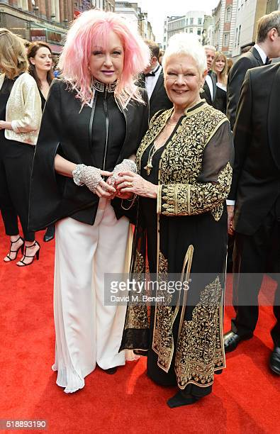 Cyndi Lauper and Dame Judi Dench arrive at The Olivier Awards with Mastercard at The Royal Opera House on April 3 2016 in London England
