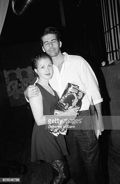 Cyndi Lauper and friend pose for a photo at a party for the premier of David Lynch's film 'Wild at Heart' on August 9th 1990 in New York City New York