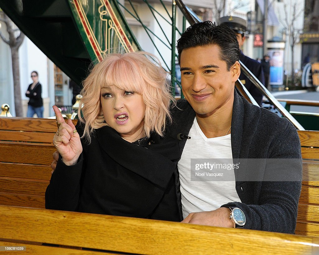 Cyndi Lauper and Mario Lopez ride the trolly at Extra at The Grove on January 10 2013 in Los Angeles California