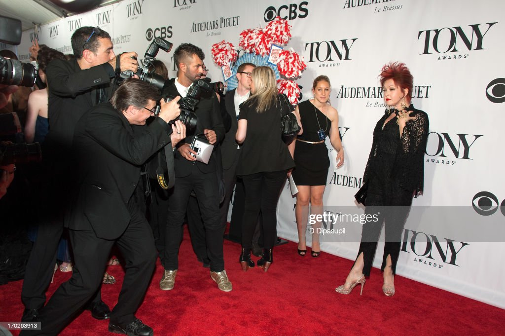 <a gi-track='captionPersonalityLinkClicked' href=/galleries/search?phrase=Cyndi+Lauper&family=editorial&specificpeople=171290 ng-click='$event.stopPropagation()'>Cyndi Lauper</a> (R) attends the 67th Annual Tony Awards at Radio City Music Hall on June 9, 2013 in New York City.