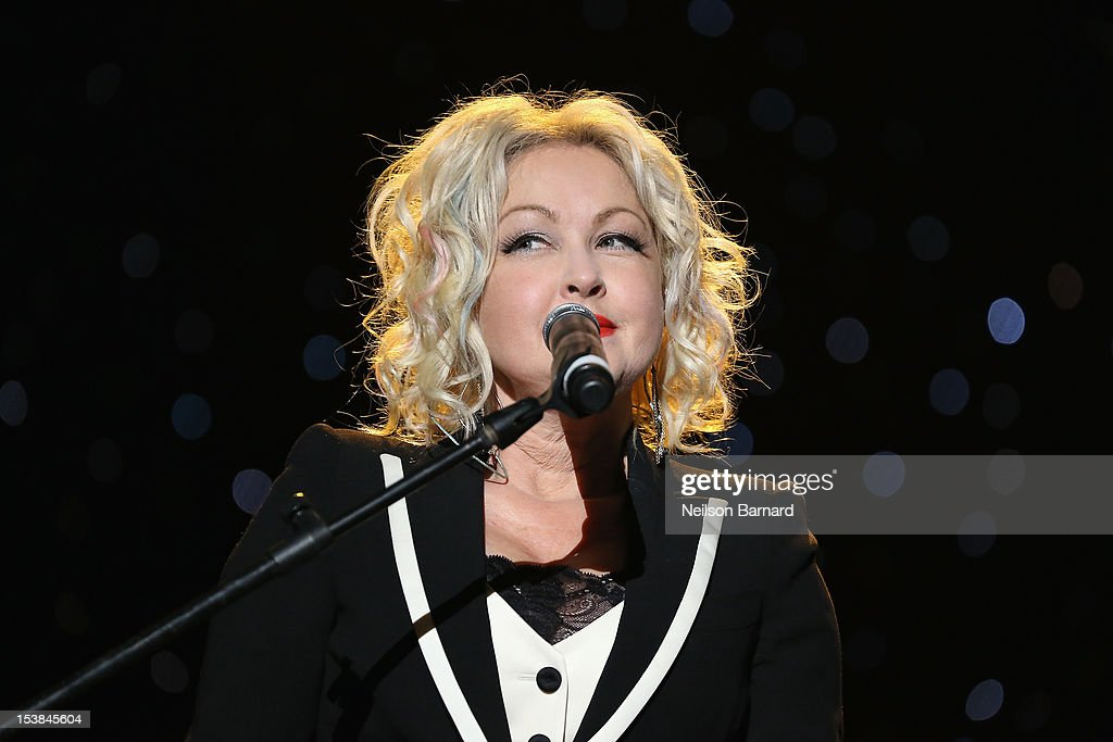 Cyndi Lauper performs onstage at the One World Concert at Syracuse University on October 9 2012 in Syracuse New York