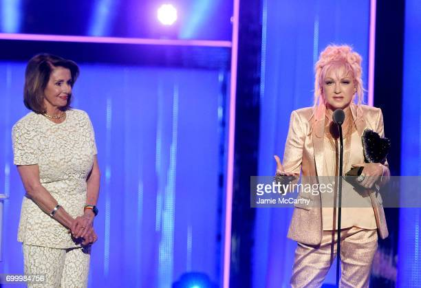 Cyndi Lauper speaks onstage with Nancy Pelosi at the Logo's 2017 Trailblazer Honors event at Cathedral of St John the Divine on June 22 2017 in New...