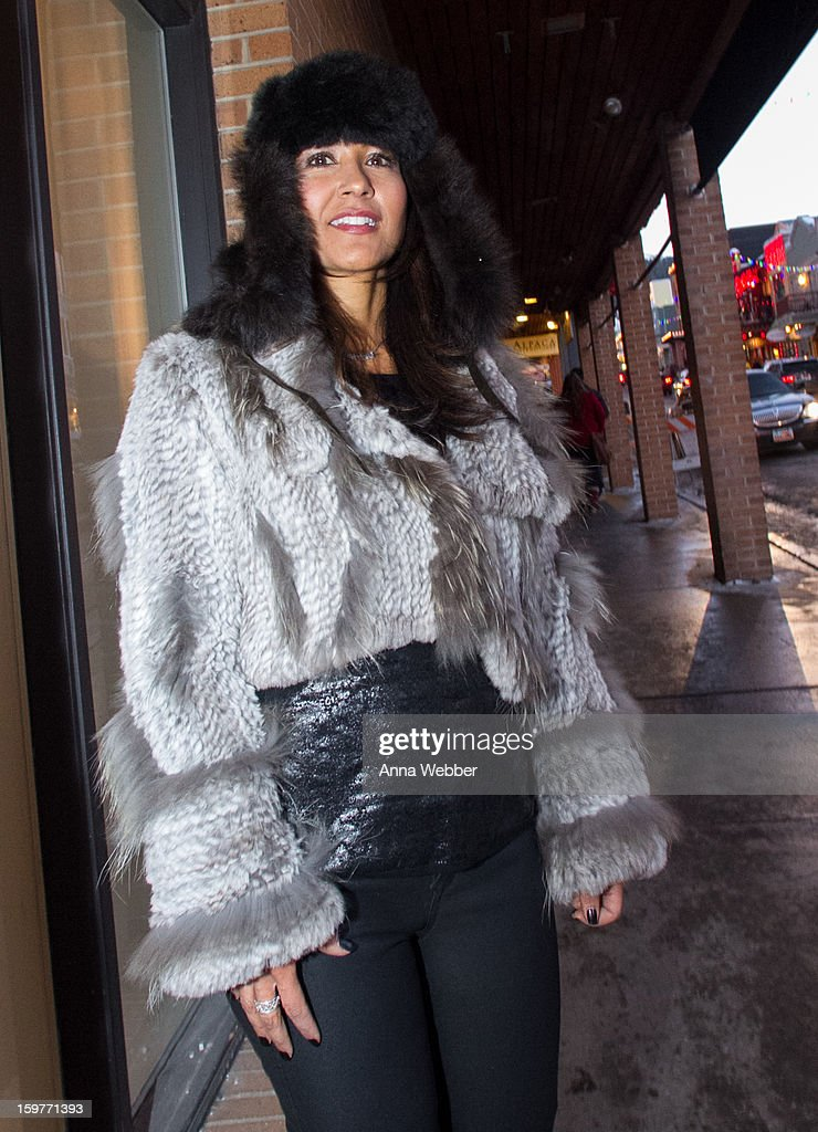 Cynthia Apodaca, owner of Frontera Talent Group from Phoenix, wearing Alpaca Boutique Park City fur hat, Flight fur jacket, Neiman Marcus top, Neiman Marcus gloves, BLEULAB leather pants from Flight in Park City, Gucci purse, Hudson Wax denim jeans and Guess by Marciano booties on January 19, 2013 on the streets of Park City, Utah.