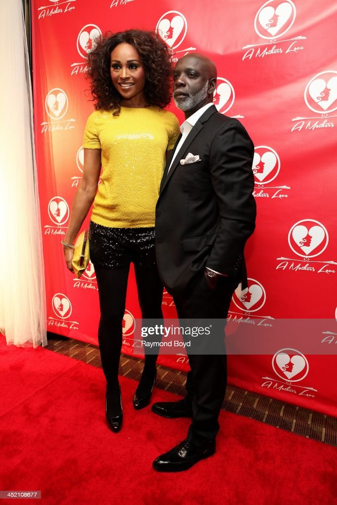 Cynthia Bailey and husband Peter Thomas from Bravo's 'Real Housewives Of Atlanta' poses for red carpet photos for 'A Mother's Love' stage play at the Rialto Center For The Arts in Atlanta, Georgia on NOVEMBER 22, 2013.