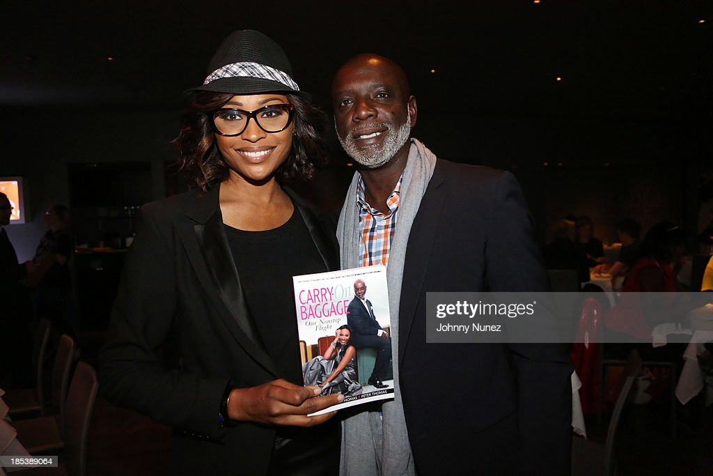 <a gi-track='captionPersonalityLinkClicked' href=/galleries/search?phrase=Cynthia+Bailey&family=editorial&specificpeople=3055318 ng-click='$event.stopPropagation()'>Cynthia Bailey</a> and Peter Thomas attend the launch event for their book 'Carry-On Baggage: Our Non-stop Flight' at Clyde Frazier's Wine and Dine on October 19, 2013 in New York City.