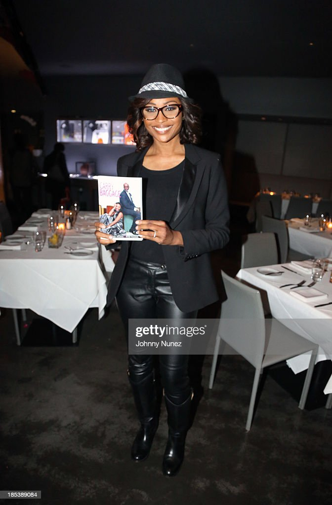<a gi-track='captionPersonalityLinkClicked' href=/galleries/search?phrase=Cynthia+Bailey&family=editorial&specificpeople=3055318 ng-click='$event.stopPropagation()'>Cynthia Bailey</a> attends the book launch for 'Carry-On Baggage: Our Non-stop Flight,' by <a gi-track='captionPersonalityLinkClicked' href=/galleries/search?phrase=Cynthia+Bailey&family=editorial&specificpeople=3055318 ng-click='$event.stopPropagation()'>Cynthia Bailey</a> and Peter Thomas at Clyde Frazier's Wine and Dine on October 19, 2013 in New York City.