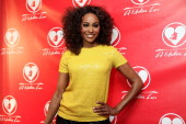 Cynthia Bailey from Bravo's 'Real Housewives Of Atlanta' poses for red carpet photos for 'A Mother's Love' stage play at the Rialto Center For The...