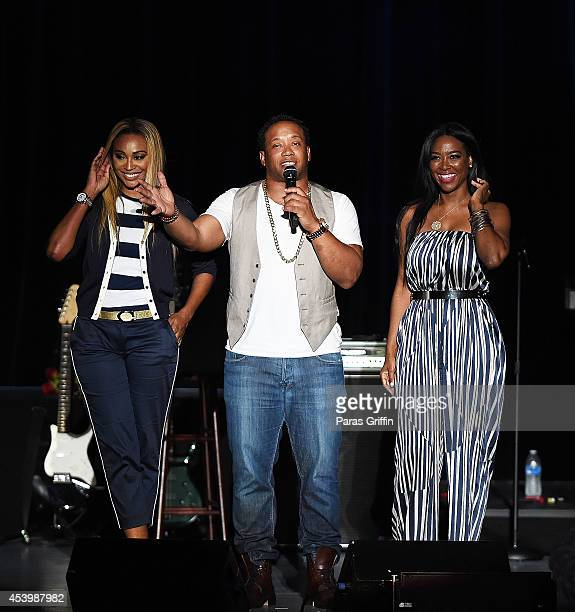 Cynthia Bailey Jamal Anderson and Kenya Moore onstage at the Boyz II Men En Vogue Concert at Chastain Park Amphitheater on August 22 2014 in Atlanta...
