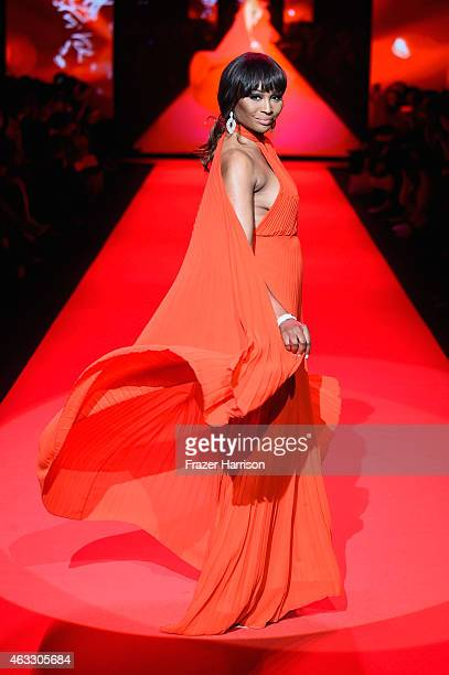 Cynthia Bailey walks the runway at the Go Red For Women Red Dress Collection 2015 presented by Macy's fashion show during MercedesBenz Fashion Week...